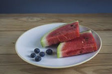 plate of watermelon slices and blueberries